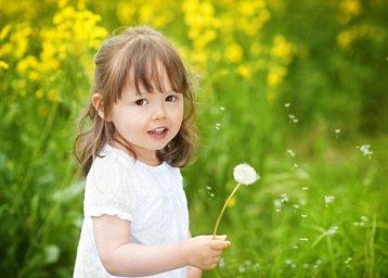 child portrait with dandelions